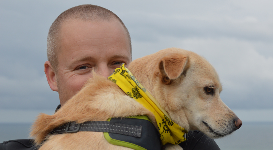 Ian Bonner, graphic designer with rescue dog Bono